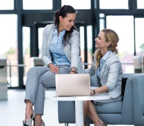 Businesswomen using laptop and having a discussion