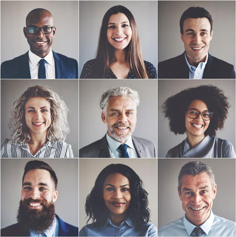 Smiling group of ethnically diverse professional businessmen and businesswomen